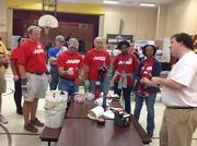AARP, in a joint effort with City Year Washington, D.C., brought  together more than 400 volunteers for a day of service in honor of Sept.  11. Volunteers were deployed to 10 sites across Washington. Here, AARP volunteers get ready to work at Orr Elementary in the District.