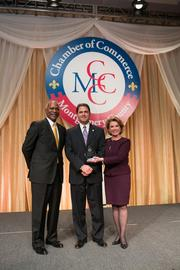 The Montgomery County Chamber of Commerce held its Annual Business  Awards Dinner on Dec. 5 at the Bethesda North Marriott Hotel and  Conference Center. The event recognizes leaders in the business and  public sector community for their accomplishments over the last year. From left, Ruben Burnett of Kaiser Permanente Mid-Atlantic States, Corporate Social Responsibility Award winner Daniel Schrider of Sandy Spring Bank and Gigi Godwin of the Montgomery County Chamber of Commerce.