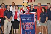 Washington Capitals alumni and mascot Slapshot visited Matthew Henson  Middle School in Indian Head, Md., on Sept. 19 for the second Capitals  Hockey School assembly of the 2012-13 school year. Washington Capital alums Sylvain Cote and Errol Rausse and mascot Slapshot pose with Matthew Henson Middle School staff following the program.