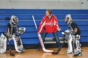 Washington Capitals goaltender Braden Holtby gives two students at Ronald Brown Middle School in D.C. goaltending tips at Capitals Hockey School on May 24.