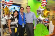 The Hope for Henry Foundation, an organization dedicated to bringing  hope and laughter to children battling life-threatening diseases,  delivered some of London's Olympic magic to Georgetown Hospital Aug. 8  when it brought in past Olympians to meet the kids. Olympic swimmer Maddy Crippen, center, with Henry's parents, Laurie Strongin and Allen Goldberg.