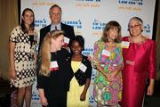 "The Children's Law Center drew a crowd of more than 400 to the Kennedy  Center's Rooftop Terrace for its annual ""Helping Children Soar"" benefit,  including, from left, Danielle Garten, Phil Horton and Marsha Tucker of Arnold & Porter; with Sky Stringer, the event's 10-year-old emcee; Roberta Horton; and Judith Sandalow, Children's Law Center's executive director."