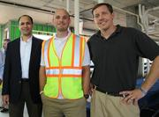 Prosperity Flats held a topping out party Aug. 27. From left, Neal Kumar of Rushmark Properties LLC, Jonathan Detwiler and Chris Marcus of Hitt.