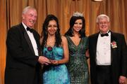 From left, Christopher Flynn, president of the PenFed Foundation; Dahlia Constantne, recipient of the PenFed Foundation's Hero at Home Award; Miss America 2012 Laura Kaeppeler; and Col. Robert Siegert III, chairman of the board of directors for the PenFed Foundation.