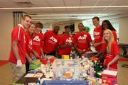 A group of AON employees joined the United Way of the National Capital Area on June 21 for a day of action to pack some of the 2,000 shoeboxes collected through the inaugural Shoebox Project.