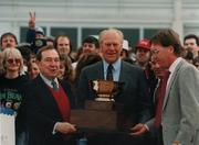 Former President Gerald Ford presents the winning cup to Joe Allbritton at the Jim Beam Stakes at Turfway Park in 1991.
