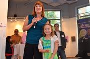 Let's Help Kids held an art auction Aug. 25 at the Greater Reston Arts  Center to raise money for children whose families are experiencing  financial hardship, and seeks to provide them with items or experience  that they otherwise couldn't afford. The nonprofit was founded by Rachel  Harris, daughter of Jen Sterling of Red Thinking. The event featured  food from Il Fornaio and a silent auction with works from local artists. Jen Sterling of Red Thinking with daughter Rachel Harris, founder of Let's Help Kids.