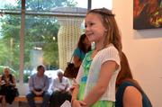 Let's Help Kids held an art auction Aug. 25 at the Greater Reston Arts  Center to raise money for children whose families are experiencing  financial hardship, and seeks to provide them with items or experience  that they otherwise couldn't afford. The nonprofit was founded by Rachel  Harris, daughter of Jen Sterling of Red Thinking. The event featured  food from Il Fornaio and a silent auction with works from local artists. Rachel Harris, founder of Let's Help Kids.
