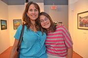 Let's Help Kids held an art auction Aug. 25 at the Greater Reston Arts  Center to raise money for children whose families are experiencing  financial hardship, and seeks to provide them with items or experience  that they otherwise couldn't afford. The nonprofit was founded by Rachel  Harris, daughter of Jen Sterling of Red Thinking. The event featured  food from Il Fornaio and a silent auction with works from local artists. Debbie Eggleston of Park Lane and her daughter Hannah.