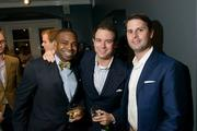 At the Michael Andrews Bespoke opening, Ashton Theodore Randle of CMI, Stefan Martinovic of City Interests LLC and Ray Schupp of Next Realty.