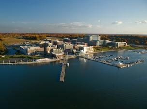 Tanger Factory Outlet Centers will open a $100 million outlet shops emporium at National Harbor.