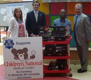 Blake Real Estate then donated the 10 Wii consoles used in the competition to Children's National Medical Center. At the ceremony for the donation were, from left, Mary Beth Bowen and Owen Billman of Blake, Milton Powell Jr. of Children's and David Bender of Blake.