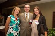 The Greater Reston Chamber of Commerce recognized its ACE winners, also known as the Awards for Chamber Excellence, during a June 28 luncheon at the Hyatt Regency Reston. Guests include, from left, Sharon Ferraro and C. Michael Ferraro of Training Solutions Inc., with Nikki Ferraro.