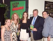 """RMR & Associates organized a client and employee appreciation night out at the Olney Theatre Center on Aug. 16. The group, including, from left, Sandra Schwartzman, Robyn Sachs, Laura Asendio and Seth Minisohn, all of RMR, and, second from right, James Kenny of JDA Strategies, attended a showing of """"Little Shop of Horrors."""""""