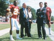 New team owner Dan Snyder made his training camp debut in the summer of 1999. Shown here with Snyder, second from left, are defensive back Darrell Green; Fred Drasner, one of the team's owners; Snyder's sister Michelle Snyder; and team consultant Jim Marshall. The photo was taken in August 1999 at Redskins training camp in Frostburg, Md.