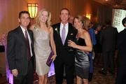 The Greater Reston Chamber of Commerce celebrated its 30th anniversary  on Dec. 1 at the Sheraton Reston Hotel. From left, Casey Veatch of Veatch Commercial Real Estate, Karen Cleveland of the Cleveland Group, Mark Ingrao of the Greater Reston Chamber of Commerce and Jolie Smith of Leadership Fairfax.