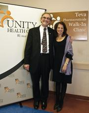 Teva Pharmaceuticals celebrated the grand opening of its Walk-In Clinic at Unity Health Care's Minnesota Avenue Health Center. Shown here are Debra Barrett, senior vice president of global government affairs and public policy for Teva Pharmaceuticals, with Vincent Keane, president and CEO of United Health Care. The clinic was funded as part of a four-year Teva commitment to Unity, under which it has contributed $500,000 since 2009.