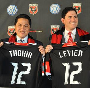 New D.C. United owners Erick Thohir and Jason Levien display their jerseys at Tuesday's press conference at the W Hotel.
