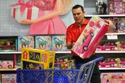 Sure, they're not playing much hockey right now, but Washington Capitals Head Coach Adam Oates and some colleagues found a way to put that down time to good use. The elves spent more than $10,000 of donated dollars on 350 toys at the Bailey's Crossroads Toys 'R' Us Dec. 6. The event was a benefit for The Salvation Army and the Capitals Toy Drive presented by Geico.
