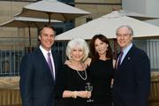 """Celebrities, business leaders, journalists and newsmakers gathered at the Phillips Collection for a reading of the first act of Trish Vradenburg's play """"Surviving Grace,"""" in which WAMU's Diane Rehm played the lead role of Grace. The event was a fundraiser for the Vradenburgs' nonprofit organization, USAgainstAlzheimer's Network, and raised $150,000. From left, Terry Moran of ABC News, Diane Rehm of NPR and WAMU, Marilu Henner and George Vradenburg."""