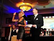 The USO of Metropolitan Washington glammed it up Hollywood-style during its Oct. 11 Stars and Stripes Benefit for the Troops at the Sheraton Pentagon City. Actress Virginia Williams and Paul McQuillan of A-T Solutions call out to raffle winners.