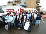 On. Dec. 18, 23 staff members from the United Way of the National Capital Area traveled to New York City to assist with Hurricane Sandy disaster recovery and relief efforts. Back row, from left: Kimberly Tate, Elizabeth Mizell, Monika Taylor, Waleed Hypolite, Sherisse Quince, Kelly Brinkley (Chief Operating Officer), Sharell Clifton, Euniesha Davis, Roxy Harris, Tony Lipari, Rose Watson, Danyell Lassiter, Jeremy Chu,  Eva Miller and Mary Ann Floto. Middle row, from left: Rhonda Small, Denise Basil, Mary Jo Bean, Courtney Ginty and Lakeshia Garrett. Front row, from left: Danielle Divittorio, Stacia Kim and Robyn Redditt.