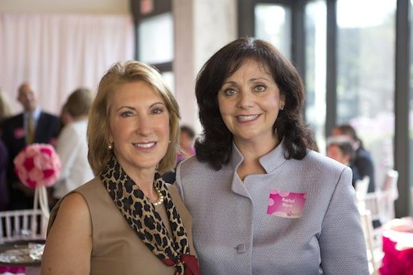 A packed room listened to breast cancer survivors Cokie Roberts and Carly Fiorina during the La Vie En Rose luncheon, held Oct. 10 at the pinked-out French Embassy and benefiting The George Washington University Medical Faculty Associates Comprehensive Breast Care Center and its Mammovan program. Fiorina, here with Dr. Rachel Brem, talked about her experiences and survivorship of the disease.