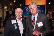Walter Galanty of AIM Meetings and Events, left, and Scott Lindley of PCI Communications checked out the booths at the Washington Business Journal's Book of Lists celebration.