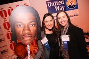 Courtney Ginty, left, and Melissa Epstein, both of United Way of the National Capital Area, posed with a cut-out version of the Washington Redskins' Robert Griffin III.