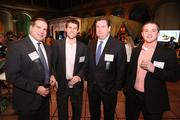 From left, Mark Esposito of Ernst & Young LLP, David Siegel of LLR Partners, Jay Farrell of ePlus Group Inc. and John Warren of AH&T Insurance caught up at the Washington Business Journal's Book of Lists celebration.