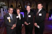 Attendees at the Washington Business Journal's Book of Lists celebration included, from left, David Bradt of WTAS LLC, Dera Cooper of J.P. Morgan, Gerry Murphy and Robert Wasalaski of J.P. Morgan.