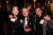 Charlie Brotman of Brotman-Winter-Fried Comm., center, caught up with Idy Marcus, left, and Sylvia Kalbian, both of QED LLC, caught up at the Washington Business Journal's Book of Lists celebration.