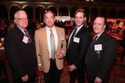 Michael Sigal of GCS Inc., second from right, enjoyed the Washington Business Journal's Book of Lists celebration with, from left, Gene Darnell, Andrew Huang and Michael Shevitz of Sigal Construction Corp.
