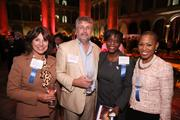 Richard Boehne of Merrick & Co., second from left, caught up with, from left, Jeannie Boehne, Robyn Redditt and Kelly Brinkley, all of the United Way of the National Capital Area.