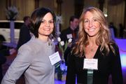 Katie Albanese, left, and Karen Vaughn, both of Concepts Inc., celebrated at the Book of Lists party on Jan. 31 at the National Building Museum.