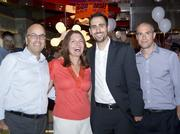 YO! Sushi opened its first U.S. location at Union Station in the District July 25. The conveyor-belt sushi-themed restaurant has plans for more locations in the Washington area. Among the guests were, from left, Howard Kar of Financial Foods, Linda Roth of Linda Roth Associates, Adam Williamowsky and Sebastian Fainbraun of Financial Foods.