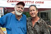 Freshfarm Markets celebrated 15 years of growing its producer-only fresh  markets with a July 15 birthday party in Dupont Circle. Bob Wollam, owner of Wollam Gardens, left, and Mark Toigo, owner of Toigo Orchards.