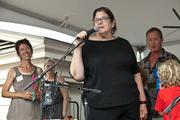 Freshfarm Markets celebrated 15 years of growing its producer-only fresh  markets with a July 15 birthday party in Dupont Circle. Chef/owner Ris Lacoste of RIS addresses the crowd.