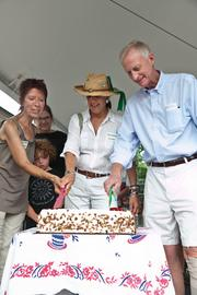 Freshfarm Markets celebrated 15 years of growing its producer-only fresh  markets with a July 15 birthday party in Dupont Circle. Freshfarm Markets co-founders and co-executive directors Bernie Price and Ann Yonkers cutting the ceremonial birthday cake with D.C. Councilmember Jack Evans.