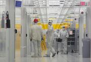 Workers in Dominion Semiconductor's fabrication plant in 2001 create silicon chips that provide memory in many kinds of electronics. Dominion Semiconductor was a joint venture between IBM and Toshiba. The facility was an advanced DRAM manufacturing facility with a 150,000-square-foot Class 1 cleanroom - the first major fab to be built in the eastern U.S. in 12 years. In 2002 it was acquired by Micron Technology.