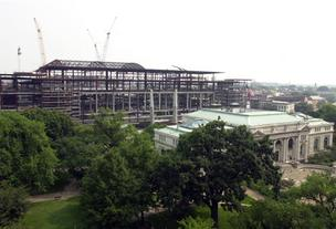 The skeleton of the Washington Convention Center under construction in June 2001 rises behind the Carnegie museum, as seen from the roof of the Renaissance Hotel.