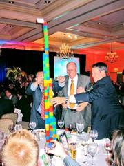 Our Best Real Estate Deals program always features heated competition, both between the deals, and around the tables as guests find ways to outdo one another in centerpiece construction, as the team from Paradigm does here. Note the business card flag proudly flying.