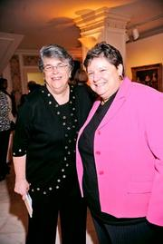 Many leaders come and go in Washington during the course of five years. Jan Verhage of the Girl Scout Council of the Nation's Capital, left, with Pat McGuire of Trinity Washington University, headed to New York to become COO of the organization.
