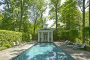 This swimming pool and pool house is one of the few additions to the property since its construction more than seven decades ago.