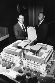 Giuseppe Cecchi and D.C. Councilman John Wilson are pictured in the early 1980s with the model of Techworld Plaza, one of Cecchi's most contentious developments. It was supposed to be a $300 million high tech trade center next to the Washington Convention Center. After three years in court, Cecchi walked away with the Renaissance Washington. Cecchi also bought back a portion of the Techworld site with hopes to expand the Renaissance to make way for a 1,400-room headquarters hotel for the new convention center. A couple years later, Cecchi sold that portion of the Techworld site to John Akridge Cos.