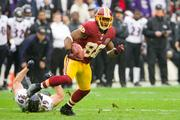 Pierre Garcon breaks a tackle against the Baltimore Ravens.