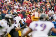 Baltimore Ravens defenders in pursuit of an ever-elusive Robert Griffin III. He rushed for 34 yards on seven carries.