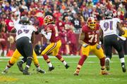 Robert Griffin III, in the pocket. Offensive tackle Trent Williams (No. 71), an anchor of the line, provides protection.