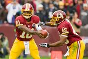Robert Griffin III and Alfred Morris executing the Redskins' Pistol offense, which has flummoxed defenses all season.