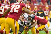 Baltimore Ravens running back Ray Rice lowers his shoulder into Redskins linebacker Perry Riley.